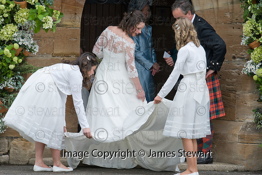 Bride, Camilla Hook, gets some final adjustments to her dress as she makes her way into Aberlady Church to marry Sam Holland, grandson of Lord Attenborough  .......