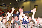 Cllr Michael Cahill celebrates with his son Brian and his supporters at the Kerry County Council Killorglin area election count in the Aura Sports Centre in Killarney on Saturday