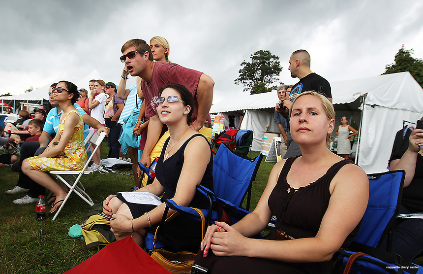 Sarah Howard, second from right, and Alicia Carter, right, both of Gonic, N.H., watch the riders with others during the Jumper Classic in Hampton Falls, N.H., Sunday, Aug. 12, 2012. (Portsmouth Herald Photo Cheryl Senter)