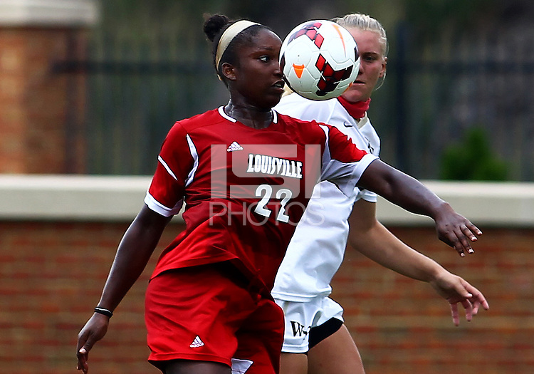 WINSTON-SALEM, NORTH CAROLINA - September 01, 2013:<br /> Christine Exeter (22) of Louisville University pushes the ball forward against Caralee Keppler (20) of Wake Forest University during a match at the Wake Forest Invitational tournament at Wake Forest University on September 01. The match was abandoned early in the second half due to severe weather with Wake leading 1-0.