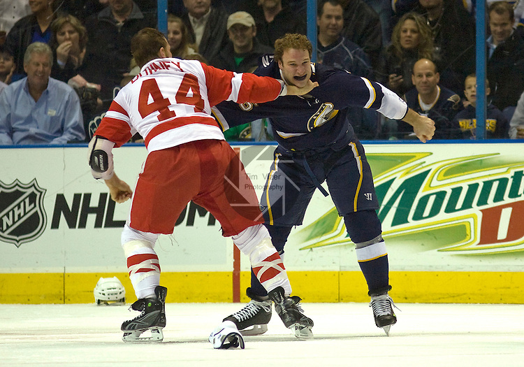 March 03 2009        Red Wings player Aaron Downey (44) fights Blues player Cam Janssen in the first period.  The St. Louis Blues hosted the Detroit Red Wings on Tuesday March 3, 2009 at the Scottrade Center in downtown St. Louis, Missouri...         *******EDITORIAL USE ONLY*******