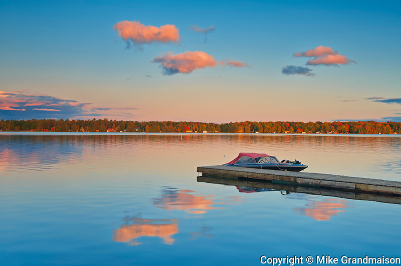 Dock and boats on Silent Lake at sunset<br />