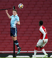 Blackpool U18's Nathan Shaw heads clear under pressure from Arsenal U18's Fol Balogun<br /> <br /> Photographer Andrew Kearns/CameraSport<br /> <br /> Emirates FA Youth Cup Semi- Final Second Leg - Arsenal U18 v Blackpool U18 - Monday 16th April 2018 - Emirates Stadium - London<br />  <br /> World Copyright &copy; 2018 CameraSport. All rights reserved. 43 Linden Ave. Countesthorpe. Leicester. England. LE8 5PG - Tel: +44 (0) 116 277 4147 - admin@camerasport.com - www.camerasport.com