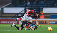 Matt Bloomfield of Wycombe Wanderers & Peter Murphy of Morecambe go down after battling for the ball during the Sky Bet League 2 match between Wycombe Wanderers and Morecambe at Adams Park, High Wycombe, England on 2 January 2016. Photo by Andy Rowland / PRiME Media Images