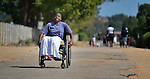 Caroline Mandishona moves along a street near her home in Bulawayo, Zimbabwe. Mandishona suffered cerebral palsy and uses a wheelchair provided by the Jairos Jiri Association with support from CBM-US.