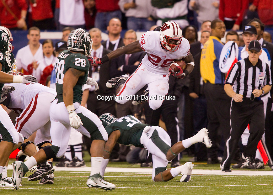 Wisconsin Badgers running back Montee Ball (28) carries the ball during the Big Ten Conference Championship NCAA college football game against the Michigan State Spartans on December 3 , 2011 in Indianapolis, Indiana. The Badgers won 42-39. (Photo by David Stluka)