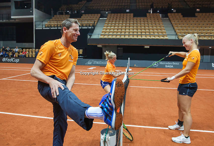 13 April, 2016, France, Trélazé, Arena Loire,   Semifinal FedCup, France-Netherlands, Dutch team warming up, captain Paul Haarhuis making fun of his stretching, in the middle Richel Hogenkamp and right Kiki Bertens<br /> Photo:Tennisimages/Henk Koster