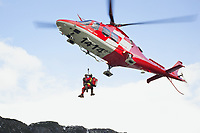 "Switzerland. Canton Grisons. Lai da Marmorera (Marmorera Stausee). A Rega Agusta AW109 SP Grand ""Da Vinci"" helicopter has rescued a swiss german hunter with an broken shoulder. By using a rescue hoist, a helicopter can rescue persons from hard-to-reach areas in the Alps. The Vertical Rescue Triangular Harness secures the emergency physician, Doctor Alessandro Genini and the patient during a lift. The Vertical Rescue Triangular Harness is a simple yet robust patient lifting sling designed for all forms of rapid vertical extrications. The simple design allows the harness to be applied to the patient easily and quickly compared to other full body rescue harnesses. All Rega helicopters carry a crew of three: a pilot, an emergency physician, and a paramedic who is also trained to assist the pilot for radio communication, navigation, terrain/object avoidance, and winch operations. The name Rega was created by combining letters from the name ""Swiss Air Rescue Guard"" as it was written in German (Schweizerische Rettungsflugwacht), French (Garde Aérienne Suisse de Sauvetage), and Italian (Guardia Aerea Svizzera di Soccorso). Rega is a private, non-profit air rescue service that provides emergency medical assistance in Switzerland. Rega mainly assists with mountain rescues, though it will also operate in other terrains when needed, most notably during life-threatening emergencies. As a non-profit foundation, Rega does not receive financial assistance from any government. People in distress can call for a helicopter rescue directly (phone number 1414). The AgustaWestland AW109 is a lightweight, twin-engine, helicopter built by the Italian manufacturer Leonardo S.p.A. (formerly AgustaWestland, Leonardo-Finmeccanica and Finmeccanica). Leonardo S.p.A is an Italian global high-tech company and one of the key players in aerospace. In close collaboration with the manufacturer, the Da Vinci has been specially designed to cater for Rega's particular requirements as regards carrying ou"