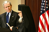 Washington, D.C. - March 28, 2005 -- United States President George W. Bush listens as Archbishop Demetrios Trakatellis delivers brief remarks Monday, March 28, 2005, during a celebration of Greek Independence Day at the Eisenhower Executive Office Building in Washington DC.  <br /> Mandatory Credit: Krisanne Johnson - White House via CNP