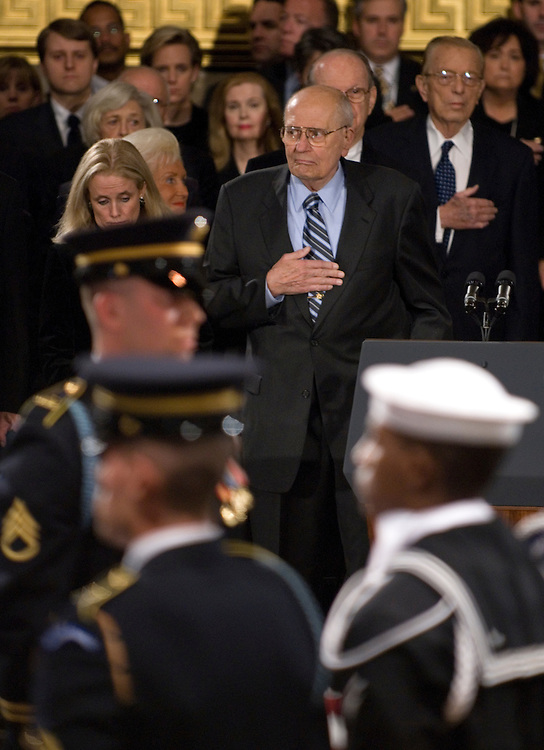 Rep. John Dingell, D-Mich., holds his hand over his heart during the state funeral for former President Gerald Ford in the Rotunda of the U.S. Capitol in Washington on Saturday evening, Dec. 30, 2006.