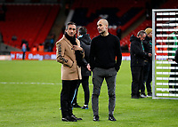 1st March 2020; Wembley Stadium, London, England; Carabao Cup Final, League Cup, Aston Villa versus Manchester City; Manchester City Manager Pep Guardiola with long time friend Manel Estiarte while on the pitch as the Manchester City players collect the EFL Cup Trophy