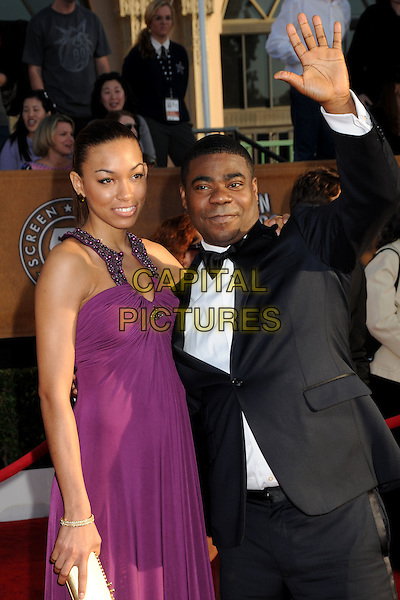 TANISHA HALL & TRACY MORGAN.16th Annual Screen Actors Guild Awards - Arrivals held at The Shrine Auditorium, Los Angeles, California, USA..January 23rd, 2009.SAG SAGs half length purple dress black tuxedo married husband wife hand arm palm waving .CAP/ADM/BP.©Byron Purvis/Admedia/Capital Pictures