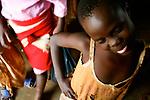 A playful primary school student in Jinja, Uganda