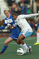 Chicago Red Stars midfielder Zakiya Bywaters (6) dribbles as Boston Breakers midfielder Joanna Lohman (11) pressures. In a National Women's Soccer League Elite (NWSL) match, the Boston Breakers (blue) defeated Chicago Red Stars (white), 4-1, at Dilboy Stadium on May 4, 2013.