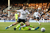 Curtis Davies of Derby County tackles Aleksander Mitrovic of Fulham during the Sky Bet Championship play off semi final 2nd leg match between Fulham and Derby County at Craven Cottage, London, England on 15 May 2018. Photo by Carlton Myrie / PRiME Media Images.