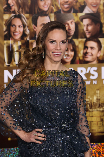 "Hilary Swank.The World Premiere of ""New Year's Eve' held at The Grauman's Chinese Theatre in Hollywood, California, USA..December 5th, 2011.half length dress hand on hip black blue sheer beads beaded  .CAP/CEL .©CelPh/Capital Pictures."