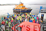 Over one hundred cyclists took part in the annual cycle from Kells to Valentia on Sunday in aid of The RNLI & Cahersiveen Hospice, pictured here on the Valentia Island Ferry with the Valentia & the Lifeboat in the background.