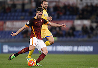 Calcio, Serie A: Roma vs Frosinone. Roma, stadio Olimpico, 30 gennaio 2016.<br /> Roma's Miralem Pjanic, left, kicks to score as he is chased by Frosinone's Paolo Sammarco during the Italian Serie A football match between Roma and Frosinone at Rome's Olympic stadium, 30 January 2016.<br /> UPDATE IMAGES PRESS/Isabella Bonotto