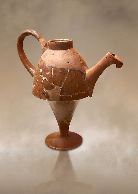 Hittite terra cotta side spouted tapered base teapot. Hittite Empire, Alaca Hoyuk, 1450 - 1200 BC. Alaca Hoyuk. Çorum Archaeological Museum, Corum, Turkey. Against a warm art bacground.