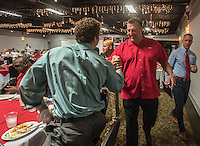 NWA Democrat-Gazette/ANTHONY REYES &bull; @NWATONYR<br /> Bret Bielema, head football coach at the University of Arkansas, greets Austin Jones, former Arkansas linebacker, Wednesday, Aug. 26, 2015 during the NWA Touchdown Club at Mermaids restaurant in Fayetteville. Bielema spoke about a few of the players, his hopes for the season and took a few questions from the audience.