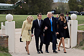U.S. First Lady Melania Trump, from right, U.S. President Donald Trump, Emmanuel Macron, France's president, and Brigitte Macron, France's first lady, walk after arriving on Marine One at the Mount Vernon estate of first U.S. President George Washington in Mount Vernon, Virginia, U.S., on Monday, April 23, 2018. As Macron arrives for the first state visit of Trump's presidency, the U.S. leader is threatening to upend the global trading system with tariffs on China, maybe Europe too. <br /> Credit: Andrew Harrer / Pool via CNP
