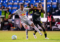 16th July 2020, Orlando, Florida, USA;  New York Red Bulls defender Kyle Duncan (6) holds off Columbus Crew midfielder Derrick Etienne (22)  during the MLS Is Back Tournament between the Columbus Crew SC versus New York Red Bulls on July 16, 2020 at the ESPN Wide World of Sports, Orlando FL.