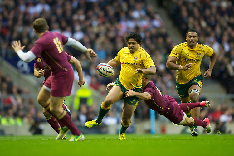 Ben Tapuai of Australia is tackled by Danny Care of England during the Cook Cup between England and Australia, part of the QBE International series, at Twickenham on Saturday 17th November 2012 (Photo by Rob Munro)