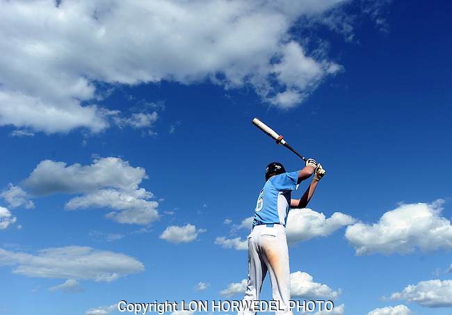 Pictures of the year 2012: A Skyline High School junior varsity baseball player warms up in the on deck circle against a blue spring sky during their game against Tecumseh, on May 10.