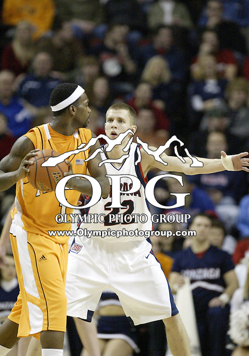 "29 December 2007:  Gonzaga Bulldogs #22 Micah Downs sets up to defend against Tennessee's #1 Tyler Smith at Key Arena in the annual ""Battle of Seattle"" in Seattle, WA. Tennessee won 82-72 over the Gonzaga Bulldogs."