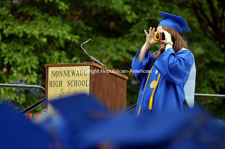 WOODLAND, CT, 25 JUNE 2011-062511JS09-- Nonnewaug High School Valedictorian pauses during her address to take a photo of the class during graduation ceremonies Saturday Nonnewaug High School in Woodbury. <br /> Jim Shannon/Republican-American
