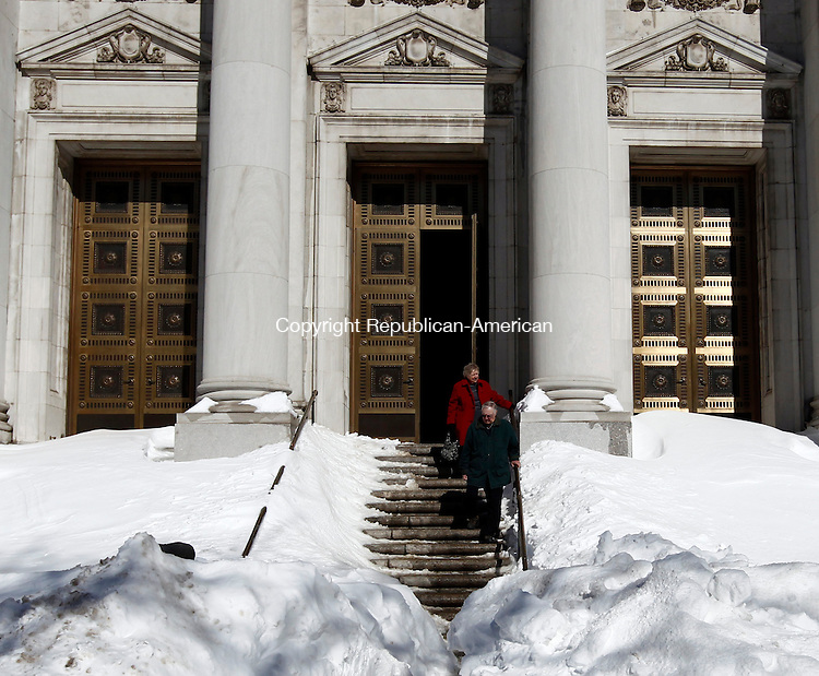 Waterbury, CT- 10 February 2013-021013CM05-  Snow covers the steps at The Basilica of the Immaculate Conception as a couple leaves the church in Waterbury Sunday morning.  The city continues dig themselves out after a blizzard dumped more than two feet of snow in the area.   Christopher Massa Republican-American