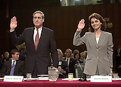 Washington, D.C. - April 14, 2004 --  Robert S. Mueller, III, Director, Federal Bureau of Investigation (FBI), left,and Maureen Baginski, Executive Assistant Director for Intelligence, FBI, right, are sworn-in to testify before the National Commission on Terrorist Attacks (9-11 Commission) in Washington, DC on April 14, 2004.<br /> Credit: Ron Sachs / CNP<br /> [RESTRICTION: No New York Metro or other Newspapers within a 75 mile radius of New York City]