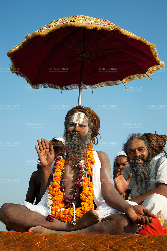 "India. Uttar Pradesh state. Allahabad. Maha Kumbh Mela. Seers and gurus seated on a four wheel drive vehicle on the day of Mauni Amavasya Snan (Royal bath for Dark moon). The ritual ""Royal Bath"" is timed to match an auspicious planetary alignment, when believers say spiritual energy flows to earth. The Kumbh Mela, believed to be the largest religious gathering is held every 12 years on the banks of the 'Sangam'- the confluence of the holy rivers Ganga, Yamuna and the mythical Saraswati. In 2013, it is estimated that nearly 80 million devotees took a bath in the water of the holy river Ganges. The belief is that bathing and taking a holy dip will wash and free one from all the past sins, get salvation and paves the way for Moksha (meaning liberation from the cycle of Life, Death and Rebirth). The Maha (great) Kumbh Mela, which comes after 12 Purna Kumbh Mela, or 144 years, is always held at Allahabad. Uttar Pradesh (abbreviated U.P.) is a state located in northern India. 10.02.13 © 2013 Didier Ruef"