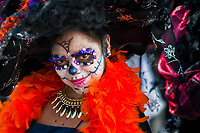 A young woman, dressed as La Catrina, a Mexican pop culture icon representing the Death, performs during the Day of the Dead festivities in Mexico City, Mexico, 29 October 2016. Day of the Dead (Día de Muertos), a syncretic religious holiday combining the death veneration rituals of the ancient Aztec culture with the Catholic practice, is celebrated throughout all Mexico. Based on the belief that the souls of the departed may come back to this world on that day, people gather at the gravesites in cemeteries praying, drinking and playing music, to joyfully remember friends or family members who have died and to support their souls on the spiritual journey.