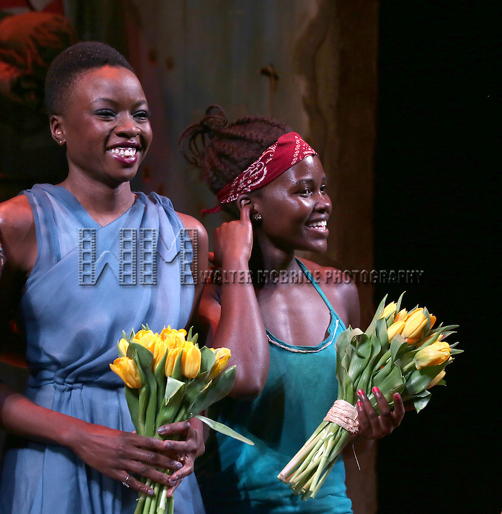 Danai Gurira and Lupita Nyong'o onstage during the 'Eclipsed' broadway opening night curtain call at The Golden Theatre on March 6, 2016 in New York City.