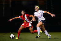 Western New York Flash midfielder Carli Lloyd (10) battles Sky Blue FC midfielder Ashley Nick (12) for the ball. The Western New York Flash defeated Sky Blue FC 2-0 during a National Women's Soccer League (NWSL) semifinal match at Sahlen's Stadium in Rochester, NY, on August 24, 2013.