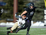 SIOUX FALLS, SD, NOVEMBER 26:  Luke Papillion #15 from the University of Sioux Falls tries to slip the grasp of Trevon Biglow #19 from Harding University Saturday afternoon at Bob Young Field in Sioux Falls. (Photo by Dave Eggen/Inertia)