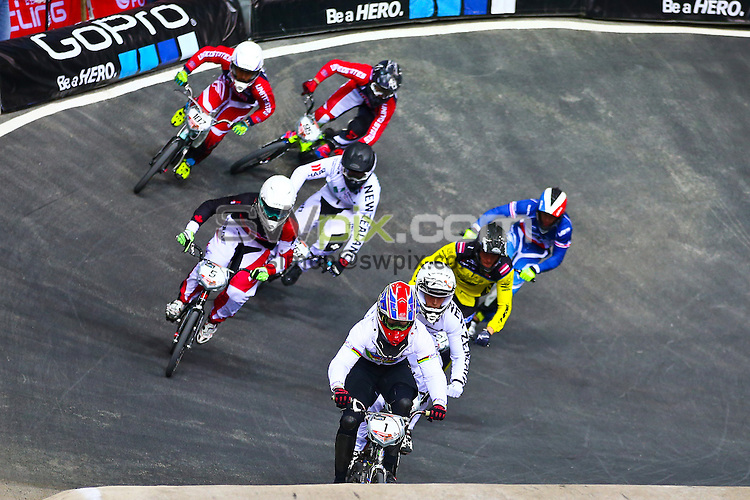 Picture by Alex Whitehead/SWpix.com - Cycling - 2014 UCI BMX Supercross World Cup - National BMX Centre, Manchester, England - 19/04/14 - Liam Phillips leads the race.