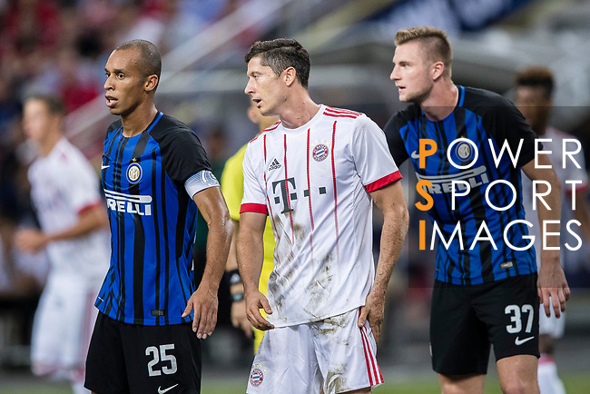 Bayern Munich Forward Robert Lewandowski (C) fights for position with FC Internazionale Defender Joao Miranda (L) during the International Champions Cup match between FC Bayern and FC Internazionale at National Stadium on July 27, 2017 in Singapore. Photo by Marcio Rodrigo Machado / Power Sport Images