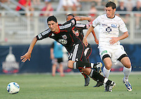 Pablo Hernandez #21 of D.C. United races away from Jason Hotchkin #11 of the Harrisburg City Islanders during a US Open Cup match at the Maryland Soccerplex on July 21 2010, in Boyds, Maryland. United won 2-0.
