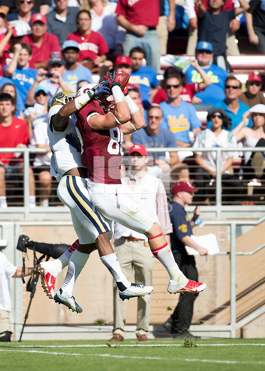 Stanford, CA -- October 19, 2013:  Stanford's Devon Cajuste makes a reception during a game against UCLA at Stanford Stadium. Stanford defeated the Bruins 24-10.