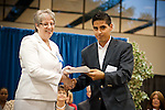 Sue Luther presents Daniel Cunningham with the Prosperity Bank Award at the 2011 Aldine Scholarship Foundation Scholarship Ceremony at Lone Star College - North Harris.