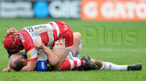 05.03.2011 Aviva Premiership Rugby Union from Kingsholm Stadium. Gloucester Rugby v Bath Rugby. Gloucester Prop (#3) Paul Doran-Jones and Bath Prop (#1) David Flatman  scrap on the floor in the second half
