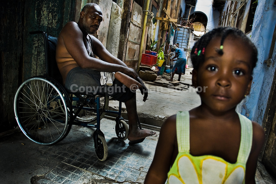 A Cuban family spend a hot afternoon in the patio of the house they live in, Havana, Cuba, 19 August 2008. About 50 years after the national rebellion, led by Fidel Castro, and adopting the communist ideology shortly after the victory, the Caribbean island of Cuba is the only country in Americas having the communist political system. Although the Cuban state-controlled economy has never been developed enough to allow Cubans living in social conditions similar to the US or to Europe, mostly middle-age and older Cubans still support the Castro Brothers' regime and the idea of the Cuban Revolution. Since the 1990s Cuba struggles with chronic economic crisis and mainly young Cubans call for the economic changes.