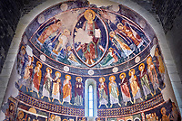 Interior Byzantine Romanesque style Christian frescoes of the central apse with Christ Pantocrator (in majesty) in a maodorla, Santissima Trinita di Saccargia, consecrated 1116 AD, Codrongianos, Sardinia.