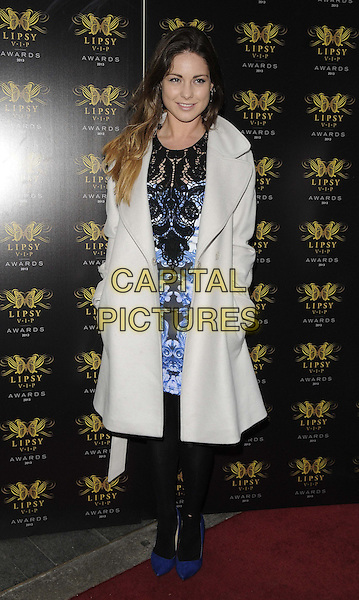 Louise Thompson<br /> The Lipsy VIP Fashion Awards 2013, DSTRKT, Rupert St., London, England.<br /> May 29th, 2013<br /> full length white coat blue black lace pattern dress tights hands in pockets<br /> CAP/CAN<br /> &copy;Can Nguyen/Capital Pictures