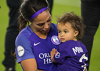 Orlando, FL - Saturday March 24, 2018: Orlando Pride forward Sydney Leroux (2) and her child after a regular season National Women's Soccer League (NWSL) match between the Orlando Pride and the Utah Royals FC at Orlando City Stadium. The game ended in a 1-1 draw.