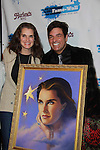 """Host Dale Badway (Loving & The City) posed with The Doctors' Brooke Shields """"Elizabeth Harrington"""" who was honored at Fame-Wall New York with the unveiling of her portrait by famed painter Jim Warren and a celebration of Broadway's The Addams Family at a Halloween Party on October 28, 2011 at Hurley's NY, New York City, New York.  (Photo by Sue Coflin/Max Photos)"""