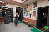 Nepal, Kathmandu. The Village Cafe in Patan serves traditional Nepalese food. Run by the non profit Sabah, employs women workers. Model released