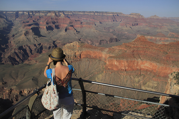 Woman standing at Pima Point Overlook at the South Rim of Grand Canyon National Park, northern Arizona, USA . John offers private photo tours in Grand Canyon National Park and throughout Arizona, Utah and Colorado. Year-round.